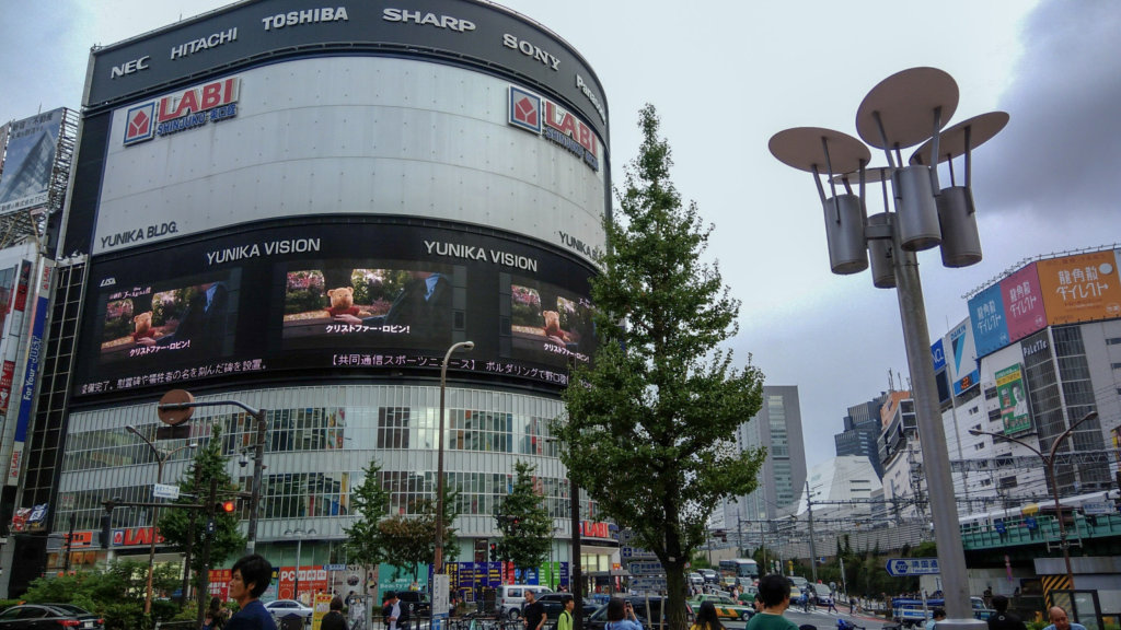 The gigantic screens draw attention of every Tokyo commuter.