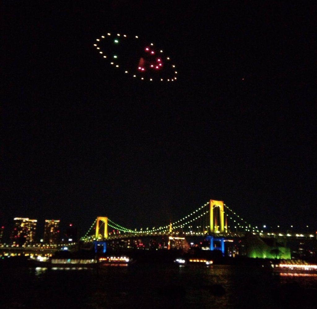 Smiley face firework and the Rainbow Bridge.